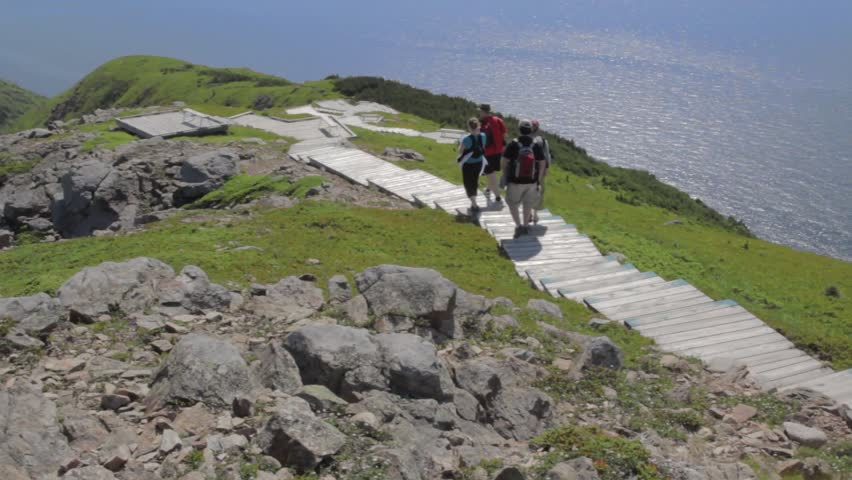 Hikers on the beautiful skyline trail in cape breton nova scotia