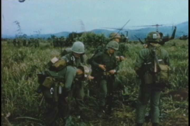 1960s - A group of soldiers are re-located and set up camp in a new location in Vietnam during the Vietnam War