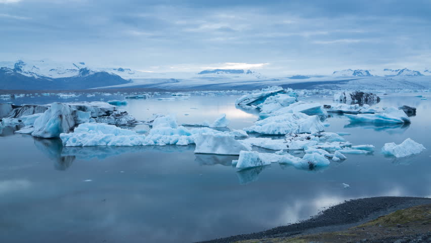 Midnight sun Time lapse of blue icebergs floating in Jokulsarlon glacial lagoon, Iceland (4K version available) | Shutterstock HD Video #4226875