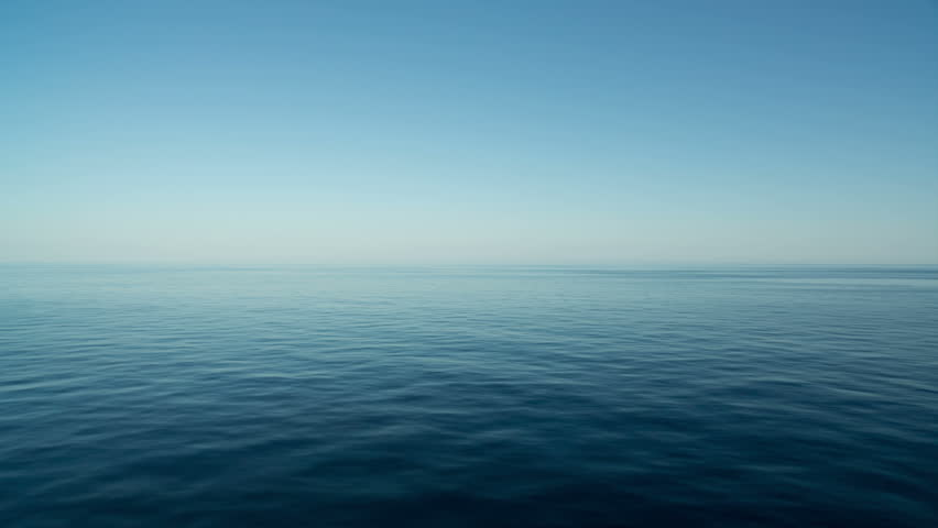 Peaceful and calm shot of a gently lapping sea and nice sky