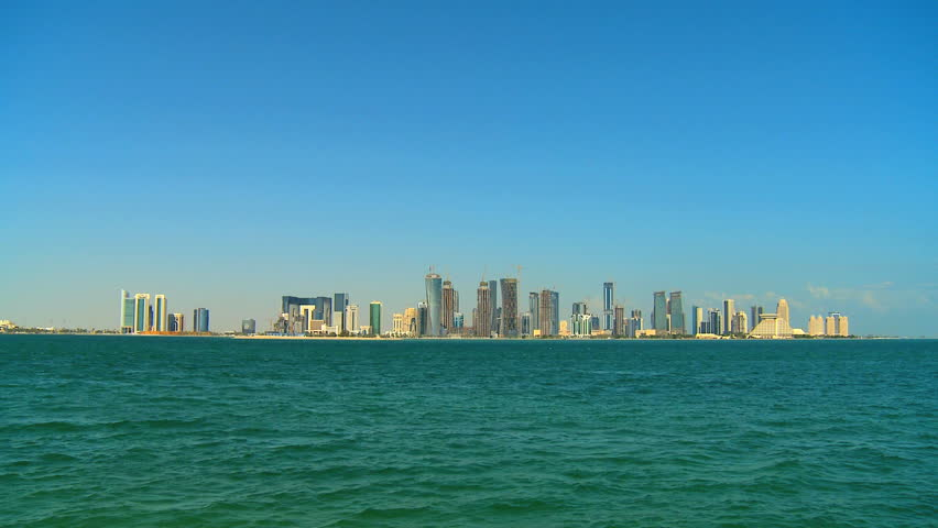 View of skyline wealthy emirate city buildings Doha Qatar in Persian Gulf