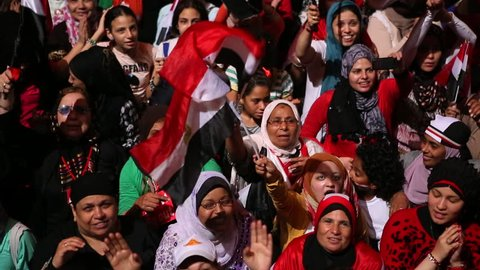 CAIRO, EGYPT - 2013: Protestors chant at a nighttime rally in Tahrir Square in Cairo, Egypt.