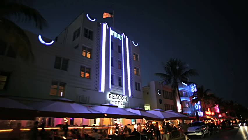 Night P.O.V. driving by illuminated restaurants on Ocean Drive Miami Art deco district of South Beach Florida, USA #4231915