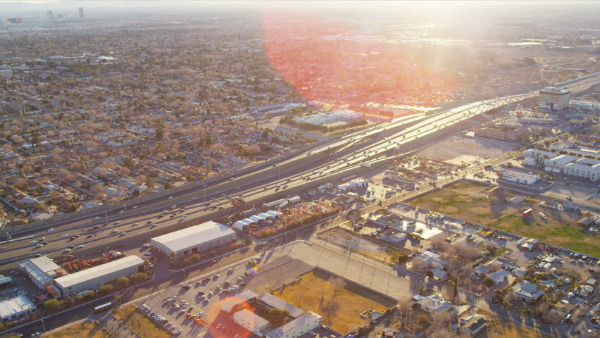 Aerial view of the suburban Freeway traffic commercial business area Las Vegas sun lens flare Nevada, USA | Shutterstock HD Video #4242395