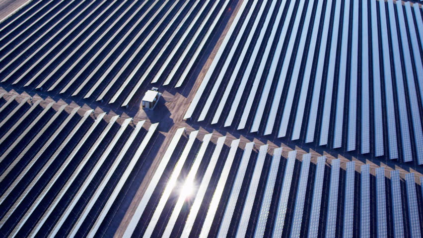 Aerial industrial view Photovoltaic solar units desert environment producing renewable energy, USA