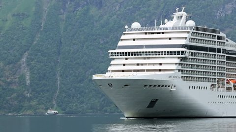 GEIRANGERFJORD, NORWAY - 12 JUNE 2013: Cruise ship approaching Geiranger in  Norway