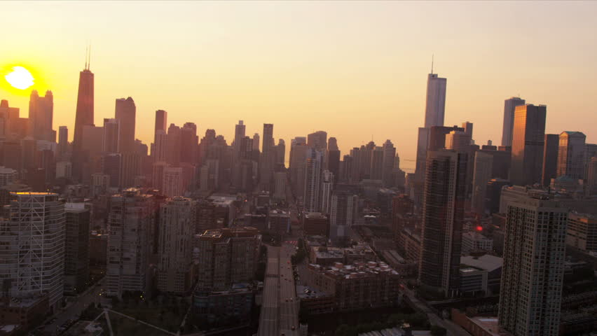 Aerial Low Level Sunrise City View Of Chicago Skyline