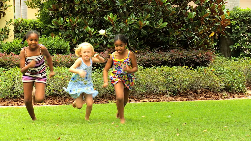 a25bfe3eb753 Little African American Caucasian girls enjoying sports day running race in  garden