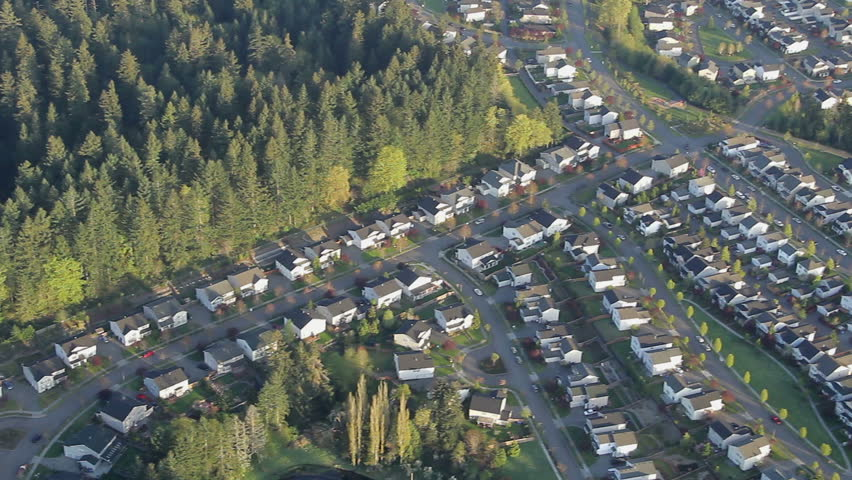 Overhead aerial view of houses, yards, and suburban communities in residential neighborhoods