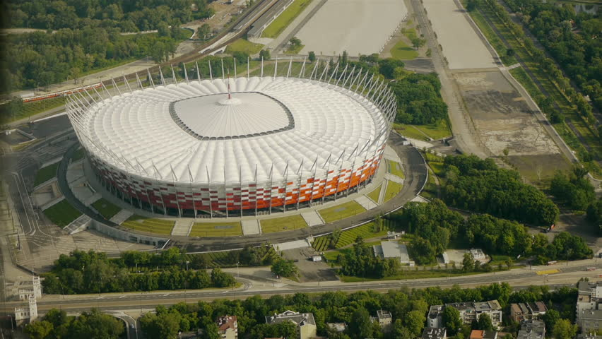 WARSAW, POLAND - CIRCA 2012: aerial view of Polish National Stadium in Warsaw train passes by on a close by railway