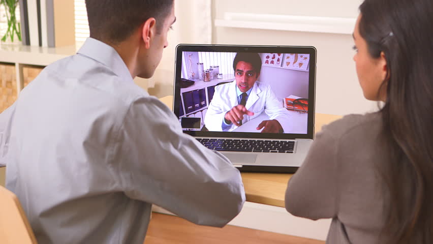 Mexican couple video chatting with doctor