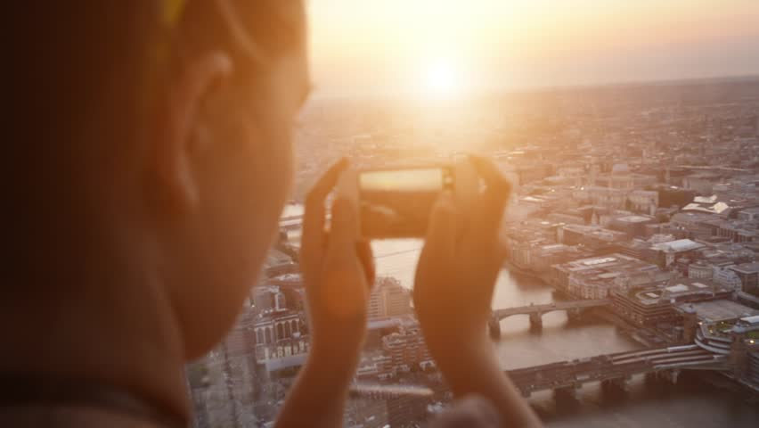 Tourist taking photograph of sunset in london skyline view from The Shard | Shutterstock Video #4291106