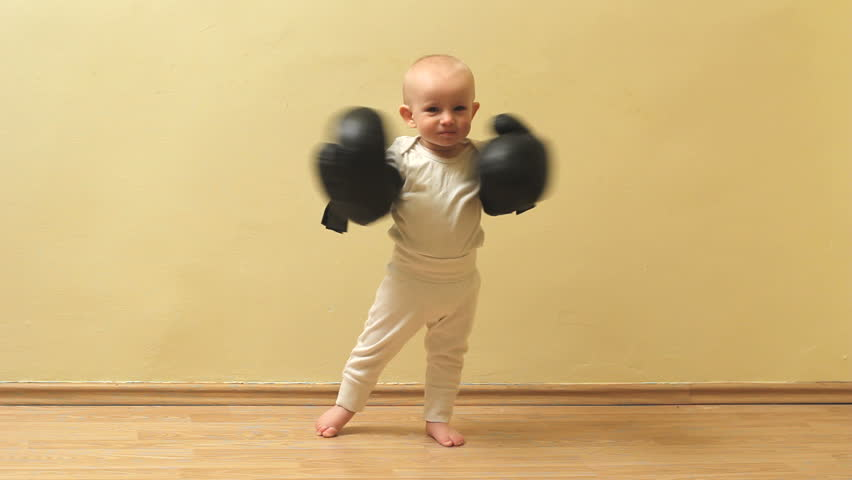 Funny little baby  threaten with his box gloves
