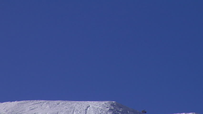 Skiers jumping into the blue sky; 2 shots