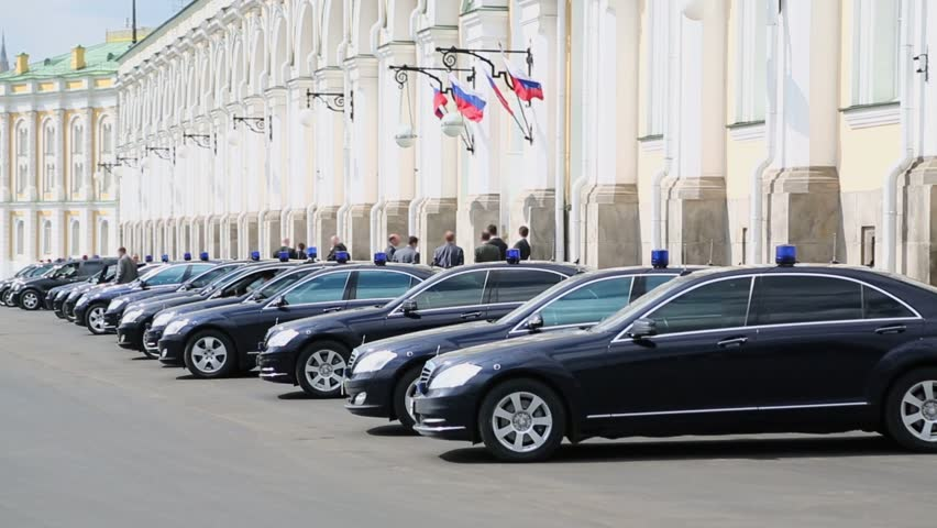 MOSCOW - APRIL 24: Black governmental cars with flashers parked near Grand Kremlin Palace, Apr 24, 2012 Moscow Russia. Armored limousines Mercedes-Benz S600 (model of V.Putin) weigh from 3 to 3.5 tons
