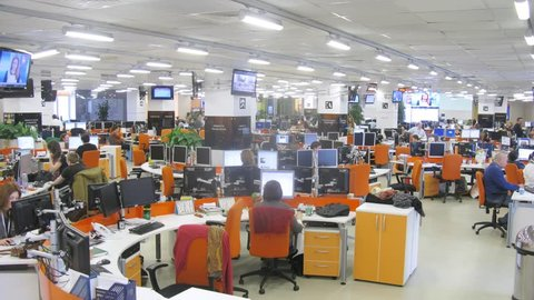 MOSCOW - MAR 05: (timelapse) Office room with desks and people working at RIA Novosti, on Mar 05, 2013 in Moscow, Russia.
