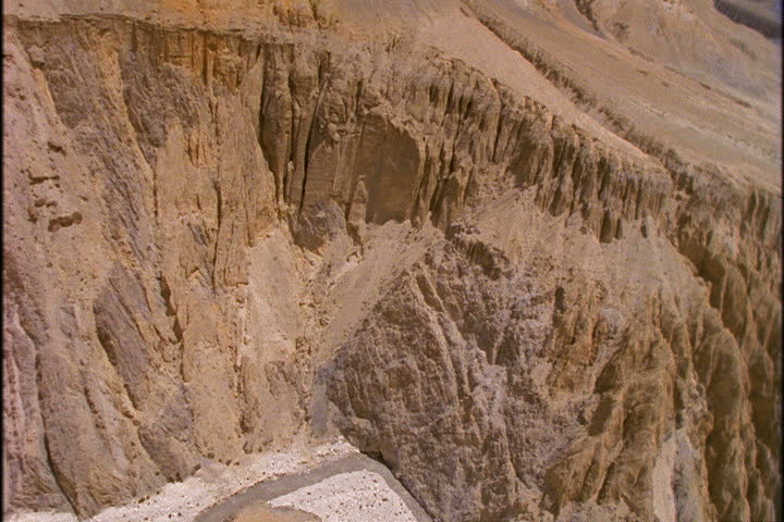 Low aerial past striated cliffs in Lo Monthang, Nepal. | Shutterstock HD Video #4327385