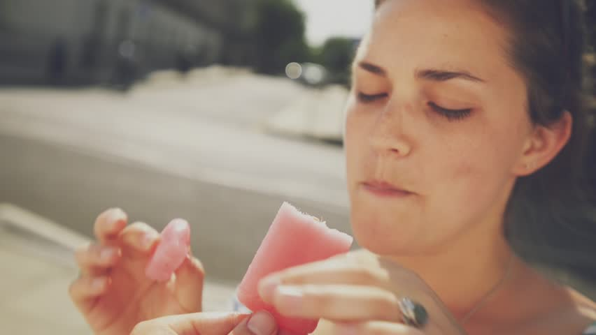 Man holding ice lolly point of view woman eating