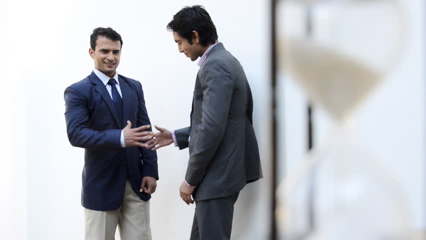Shot of two businessmen shaking their hands and talking