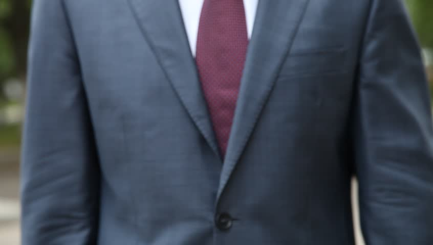 Business man tying a tie stock footage video 4466447 shutterstock successful businessman broker using calculator outdoors in a park hd stock video clip ccuart Choice Image