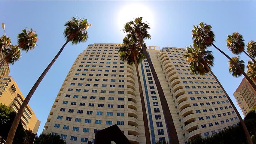LONG BEACH, CA/USA: July 17, 2013- A low angle shot rolling by high rise