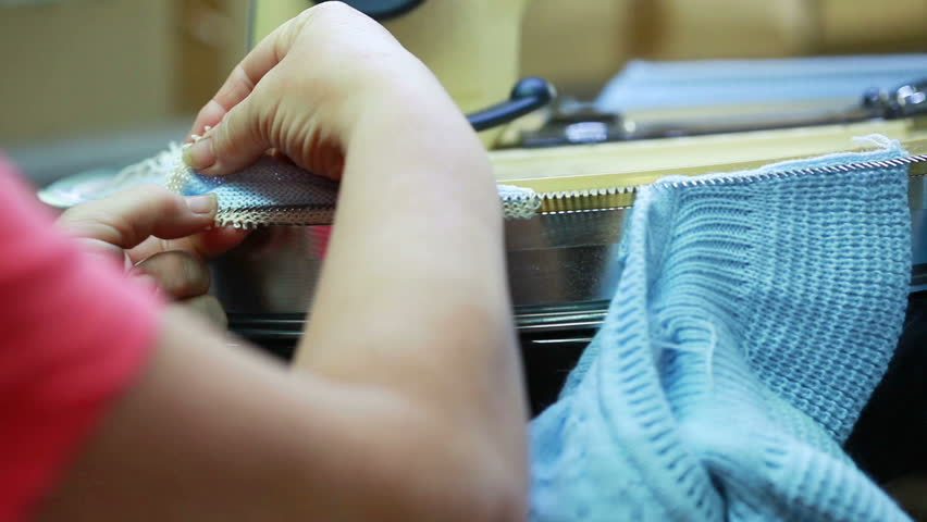 Operator straightens loop on knitted clothes | Shutterstock HD Video #4373165