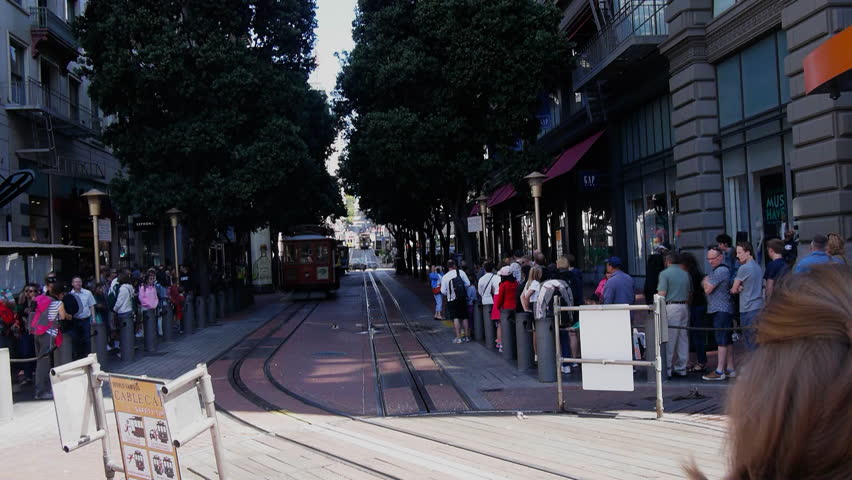 SAN FRANCISCO- JUL 8: time lapse view as drivers turn around a san francisco cable car on  the powell market turntable