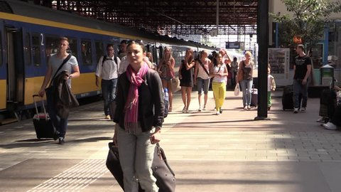 EINDHOVEN / THE NETHERLANDS - JULY 26 2013: Crowd at railway station in Eindhoven