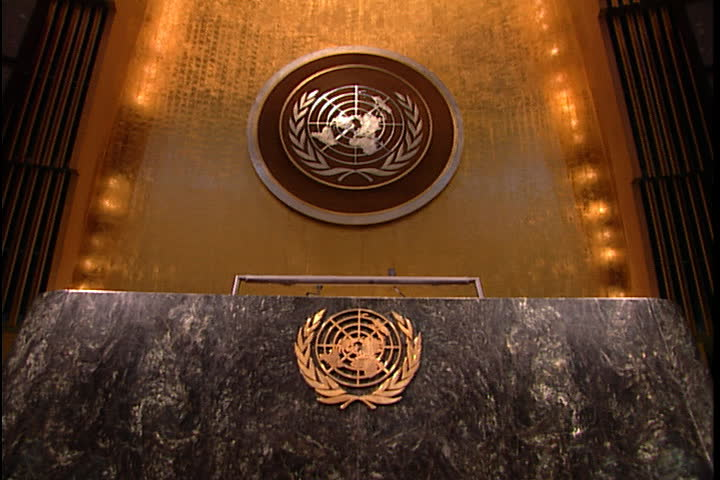 NEW YORK CITY - FEBRUARY 11, 1999: MS of the podium in the United Nations General Assembly hall: United Nations Emblem on the front of the podium in gold and on the wall behind in silver.