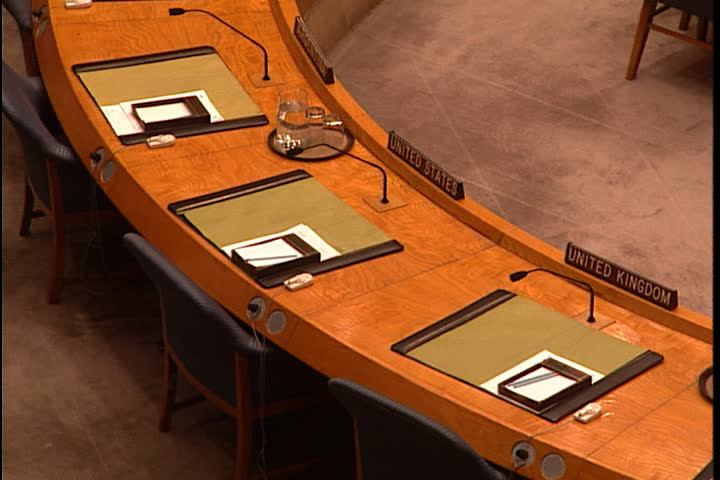 NEW YORK CITY - FEBRUARY 11, 1999: MS high angle of desks, camera zooms out to high angle WS of the Security Council chamber