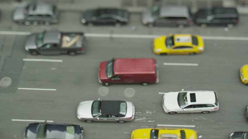Overhead view of queuing traffic on a busy New York street. In slow motion.