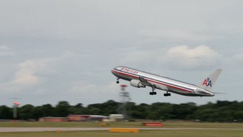 MANCHESTER, LANCASHIRE/ENGLAND - JULY 30: American Airlines Boeing 767 takes off at  on July 30, 2013 in Manchester. American Airlines is a major US airline headquartered in Fort Worth, Texas.