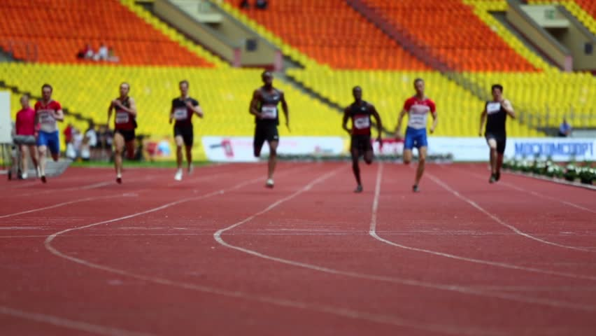 MOSCOW - JUN 11: Sportsmen run on track of Grand Sports Arena of Luzhniki Olympic Complex at international athletics competitions IAAF World Challenge Moscow Challenge on 11 June 2012, Moscow, Russia.