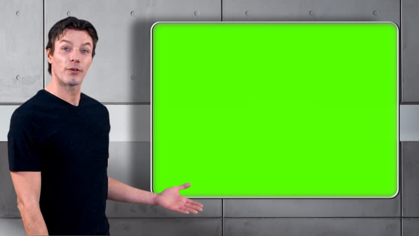 Television presenter or weatherman does piece to camera with greenscreen