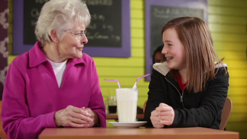 Senior woman with grandaughter in cafe