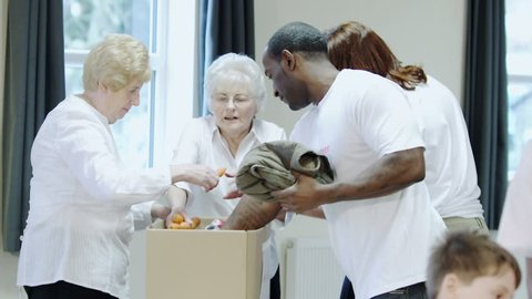 Charity volunteers and community giving a helping hand