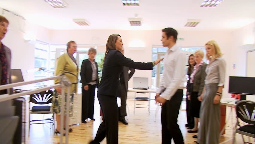Office Fight - angry office workers come to blows at work. High quality HD video footage
