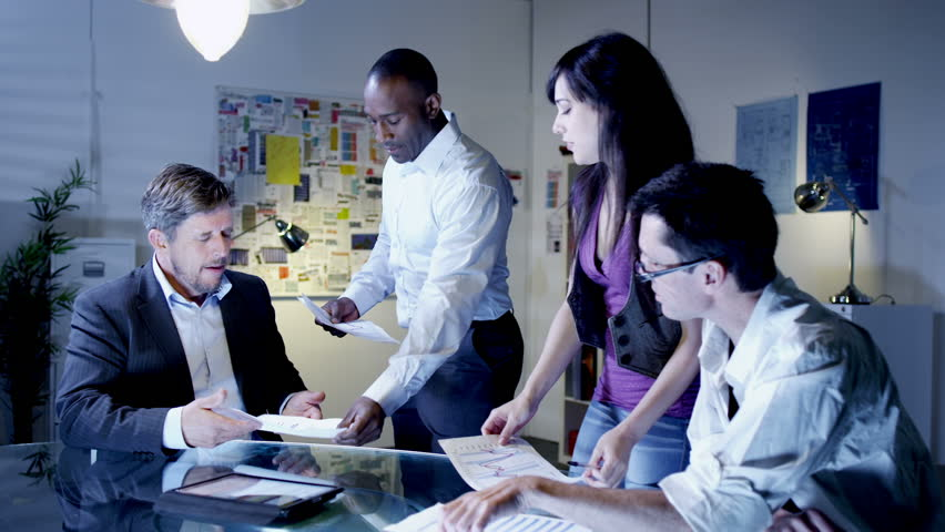 Office evening ideas meeting. Creative business team work late into the evening. | Shutterstock HD Video #4496894