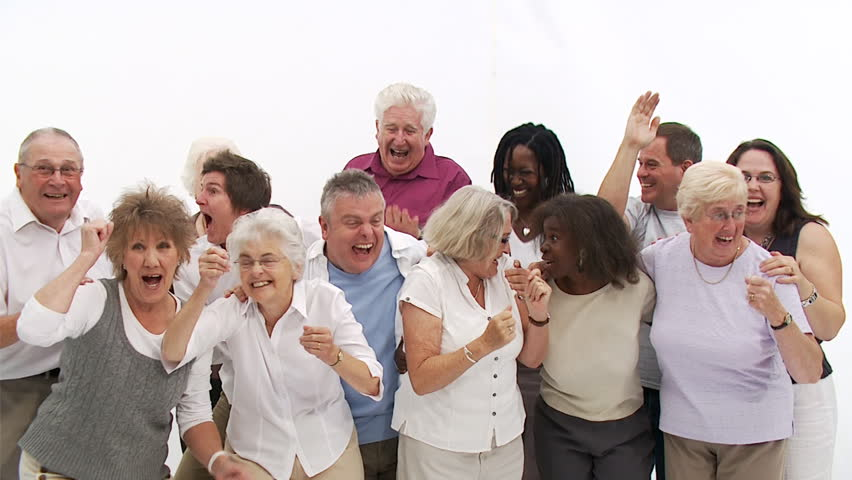 Group of senior people coming together to form a happy close group of individuals. Shot in large white studio. High quality HD video footage