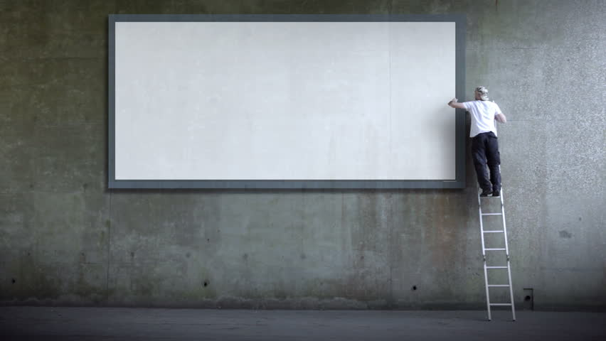 Man erects billboard poster for advertising. Blank wall for copy space advertising. Part of a series of artistic clips I'm calling 'Wall Street'. | Shutterstock HD Video #4501547