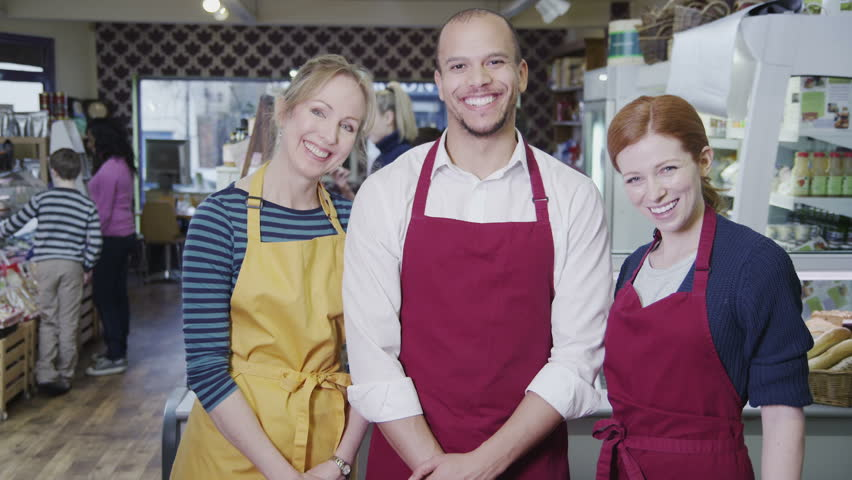 Portrait of happy male and female workers in a cafe or grocery store. | Shutterstock HD Video #4501985