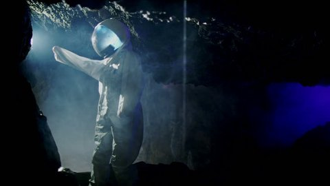 Space science fiction. An Astronaut (or Alien) in dark cave structure. A fantasy science fiction film of epic proportions.