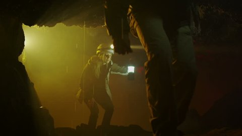 Scientists and miners exploring dark caves. Geologists, explorers, adventurers, pot holing, historians or mining company.