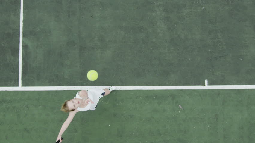 Tennis serve in slow motion from overhead angle. | Shutterstock HD Video #4503989