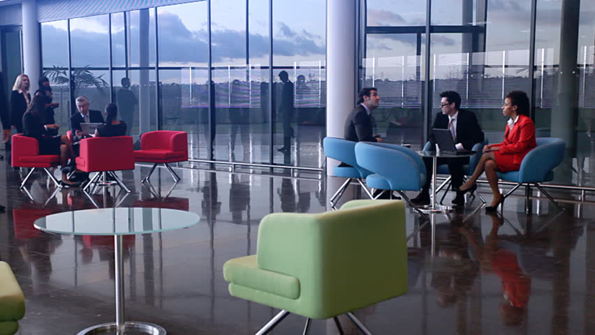 Business people inside a modern office building.
