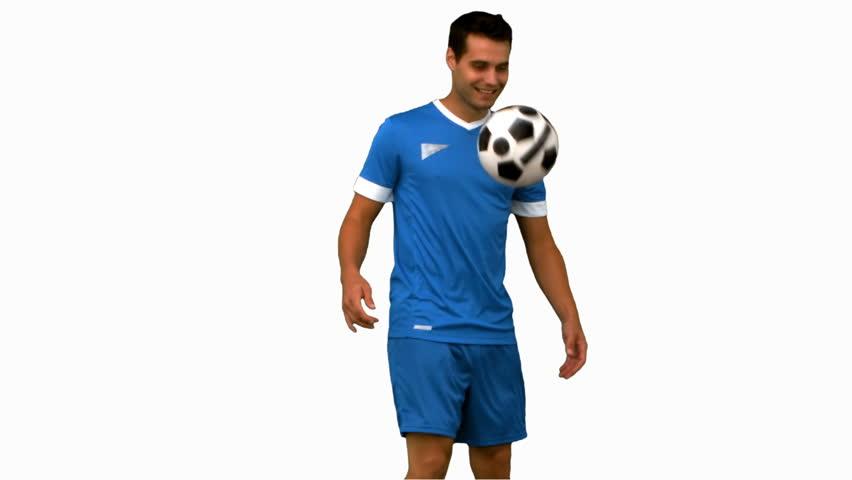 Man juggling a football on white screen | Shutterstock HD Video #4529705