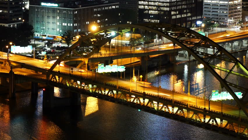 A dramatic time lapse view of traffic passing over the Fort Pitt Bridge in