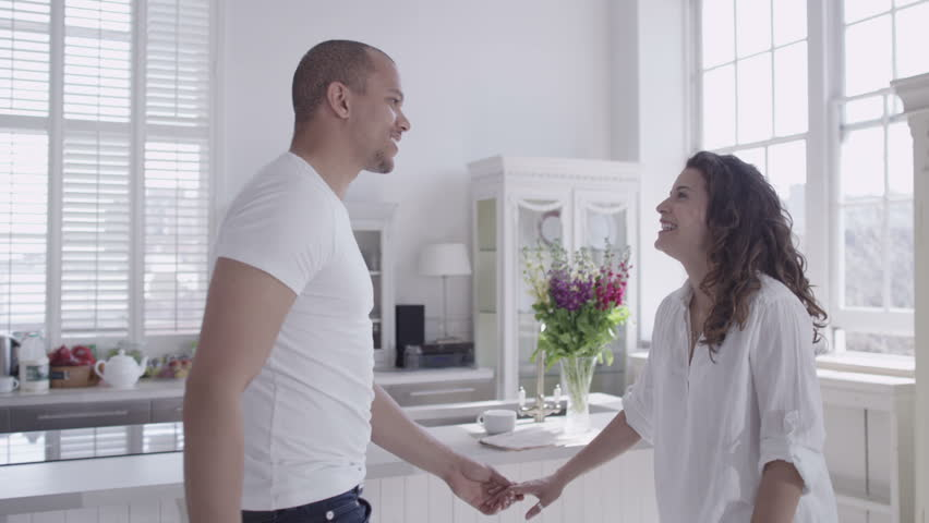 Happy and attractive young mixed race couple viewing a beautiful modern property with a view to making it their home. In slow motion. | Shutterstock HD Video #4531841