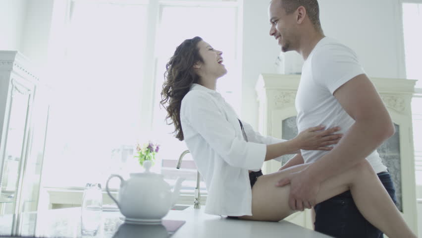 Things get hot and steamy in the kitchen as a sexy mixed race young couple start making out on the counter top. In slow motion. | Shutterstock HD Video #4533275