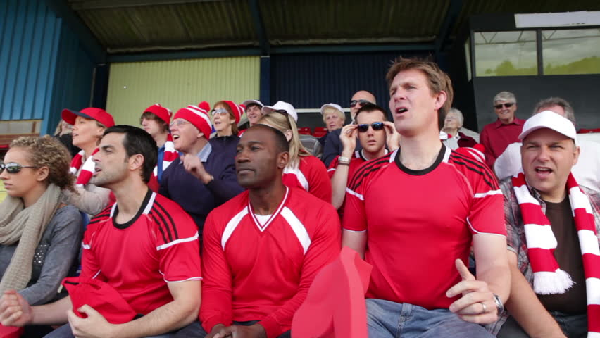 Enthusiastic crowd of spectators watching a sports game or football match and reacting  | Shutterstock HD Video #4536263